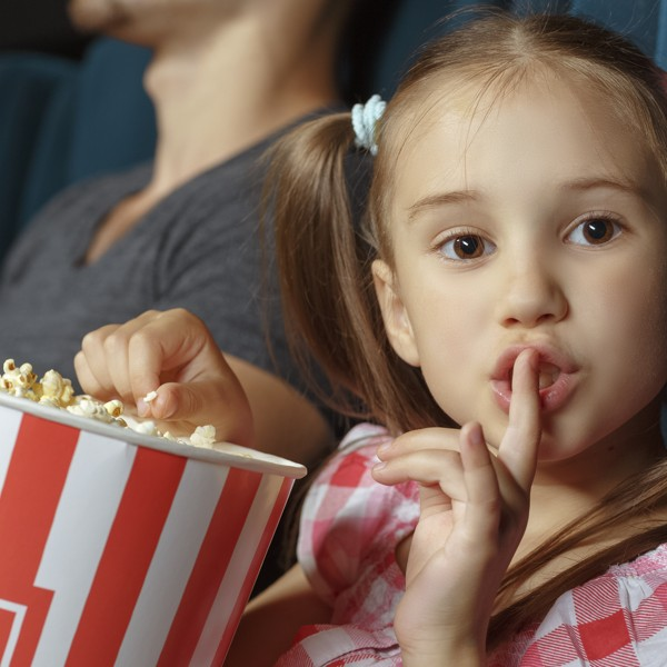 Little girl asking silence during the movie